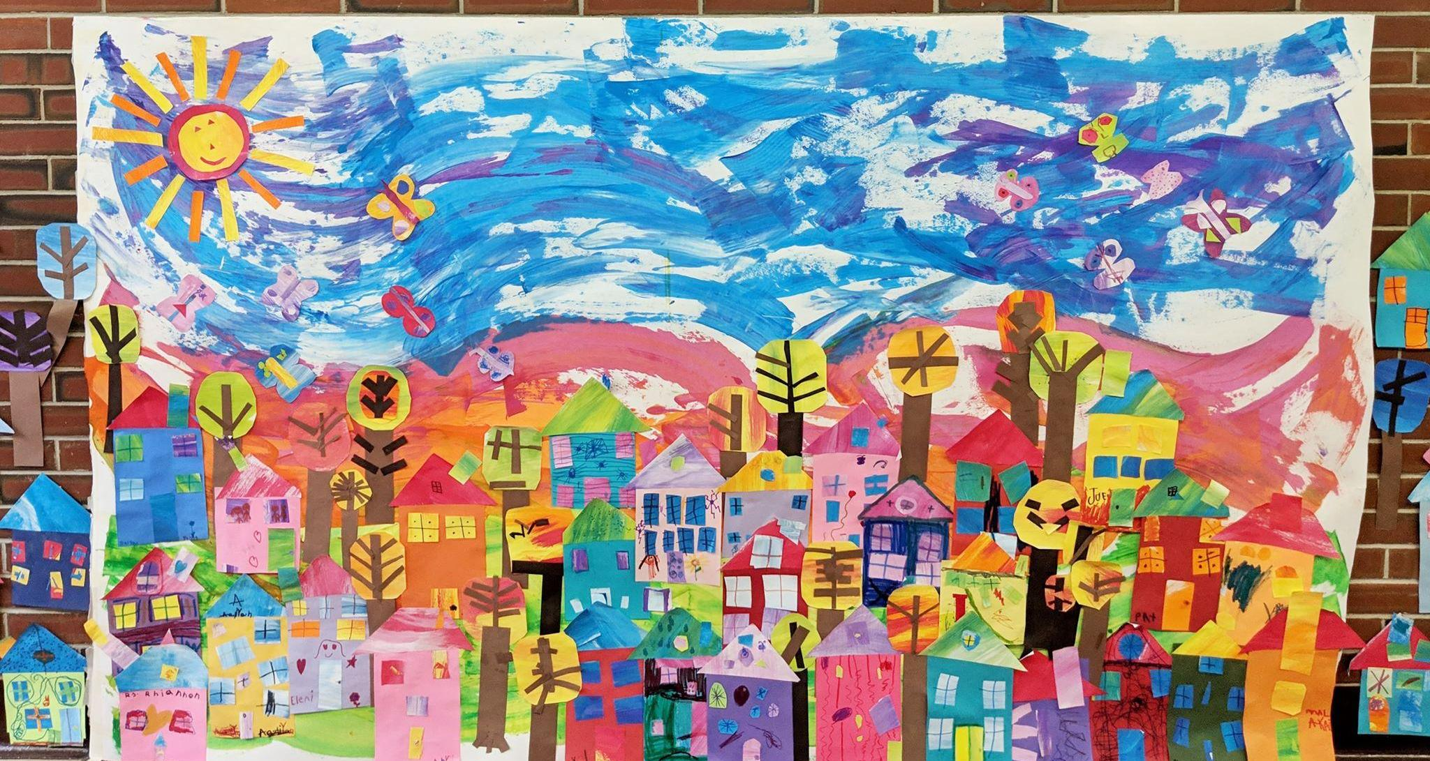 brightly colored collage with many houses, trees, blue sky and sun