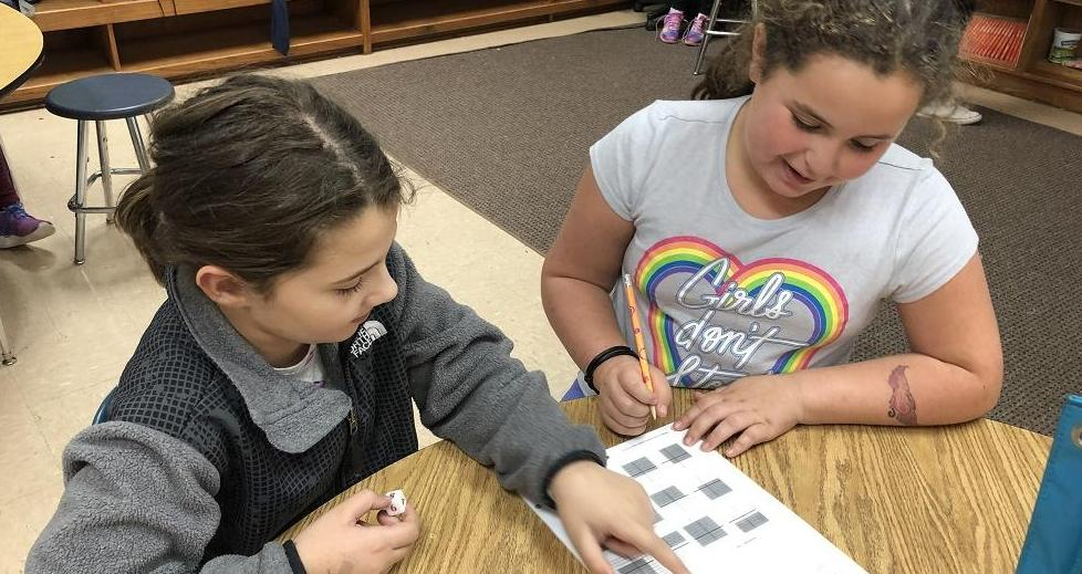 Two students working collaboratively on Math