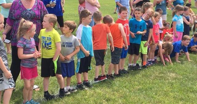 children waiting at the starting line of a footrace